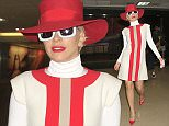 Lady Gaga arrives in Los Angeles showing off her toned legs in a red & white dress with matching hat & shoes.  The American singer, songwriter, and actress was seen arriving into LAX camera ready.  Pictured: Lady Gaga Ref: SPL1149864  131015   Picture by: Sharky / Splash News  Splash News and Pictures Los Angeles: 310-821-2666 New York: 212-619-2666 London: 870-934-2666 photodesk@splashnews.com