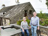 Stephen and Janine Sykes with their picturesque home and holiday let, near Newby Bridge in the Lake District National Park.\nHome Lettings feature.\nPhotograph by Richard Walker / www.imagenorth.net