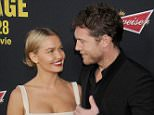 "LOS ANGELES, CA - MARCH 19:  Actor Sam Worthington and Lara Bingle arrive at the Los Angeles premiere of ""Sabotage"" at Regal Cinemas L.A. Live on March 19, 2014 in Los Angeles, California.  (Photo by Gregg DeGuire/WireImage)"