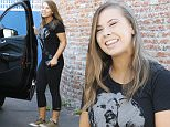 Hollywood, CA - Bindi Irwin arrives to the Dancing With the Stars studio after another perfect 10 performance on last night's show.  Bindi looked to be great spirits after last night's show and greeted her fans before walking into practice with her mom Terri.\nAKM-GSI       October 13, 2015\nTo License These Photos, Please Contact :\nSteve Ginsburg\n(310) 505-8447\n(323) 423-9397\nsteve@akmgsi.com\nsales@akmgsi.com\nor\nMaria Buda\n(917) 242-1505\nmbuda@akmgsi.com\nginsburgspalyinc@gmail.com