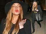 lindsay lohan & Poppy Delevingne are seen here as they leave The Chanel Party held at The Saatchi gallery in Chelsea, London. Karl Lagerfeld, Clara Paget & Laura Bailey were also seen leaving the private party.  Pictured: lindsay lohan Ref: SPL1148482  121015   Picture by: WeirPhotos  Splash News and Pictures Los Angeles: 310-821-2666 New York: 212-619-2666 London: 870-934-2666 photodesk@splashnews.com