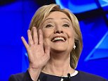 Democratic presidential candidate Hillary Rodham Clinton waves as she takes the stage before the CNN Democratic presidential debate Tuesday, Oct. 13, 2015, in Las Vegas. (AP Photo/David Becker)