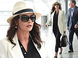 EXCLUSIVE: Catherine Zeta Jones with a feather in her hat arrives at JFK airport in NYC.\n\nPictured: Catherine Zeta Jones\nRef: SPL1151230  141015   EXCLUSIVE\nPicture by: Ron Asadorian / Splash News\n\nSplash News and Pictures\nLos Angeles: 310-821-2666\nNew York: 212-619-2666\nLondon: 870-934-2666\nphotodesk@splashnews.com\n
