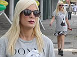 143720, Tori Spelling seen out doing some Halloween shopping with her kids in LA. Tori ended up ditching the denim vest and wore over her dress, a 90210 t-shirt with her characterís name Donna on it. Los Angeles, California - Wednesday October 14, 2015. Photograph: Sam Sharma, © PacificCoastNews. Los Angeles Office: +1 310.822.0419 sales@pacificcoastnews.com FEE MUST BE AGREED PRIOR TO USAGE\n