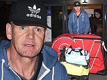 EXCLUSIVE Gordon Ramsay returns home to london after he had to be rescued by medical crews after suffering severe dehydration during an Ironman event. The celebrity chef was competing in the 2015 Ironman World Championship in Hawaii when he fell violently ill. seen arriving back at heathrow airport with his custom made bicycle. 13 October 2015. Please byline: Neil Warner - Vantagenews.com