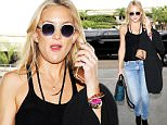 Los Angeles, CA - Kate Hudson departs from LAX on Wednesday morning. The actress and mother keeps it casual in denim and a black tank top. She's wearing white framed sunglasses and carrying her gold iPhone 6s in hand. Last night she celebrated 50 years of La Mer in Hollywood. \n  \nAKM-GSI       October 14, 2015\nTo License These Photos, Please Contact :\nSteve Ginsburg\n(310) 505-8447\n(323) 423-9397\nsteve@akmgsi.com\nsales@akmgsi.com\nor\nMaria Buda\n(917) 242-1505\nmbuda@akmgsi.com\nginsburgspalyinc@gmail.com