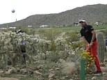 Magic: Victor Dubuisson plays his wonder shot at the 20th hole