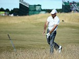 ... and the former Masters champion's club snaps into two pieces after it hits the ground