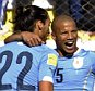 Uruguay's defender Martin Caceres (L) celebrates with teammate Carlos Sanchez after scoring against Bolivia during the Russia 2018 FIFA World Cup qualifiers match, at the Hernando Siles stadium in La Paz, on October 8, 2015.   AFP PHOTO / JORGE BERNALJORGE BERNAL/AFP/Getty Images