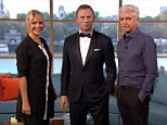 BOND GIRL HOLLY WILLOUGHBY INTRODUCES VIEWERS TO HER NEW THIS MORNING CO-HOST IN A FUN SKETCH! 3.jpg