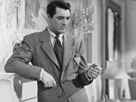 1941:  British born actor Cary Grant (1904 - 1986) leans against a mantelpiece smoking a cigarette in a scene from 'Suspicion', directed by Alfred Hitchcock.  (Photo via John Kobal Foundation/Getty Images)