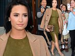 Demi Lovato takes photo  with funs coming out of a hotel in NYC.\n\nPictured: Demi Lovato\nRef: SPL1152446  151015  \nPicture by: @JDH Imagez / Splash News\n\nSplash News and Pictures\nLos Angeles: 310-821-2666\nNew York: 212-619-2666\nLondon: 870-934-2666\nphotodesk@splashnews.com\n
