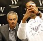 Chelsea football club manager Jose Mourinho poses for a photo during a book signing to promote the book 'Mourinho' at a book store in London, Thursday, Oct. 15, 2015.  (AP Photo/Frank Augstein)