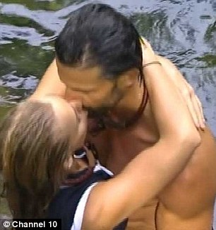 Loved up: Tim and Anna shared some steamy kisses after entering I'm A Celebrity as intruders