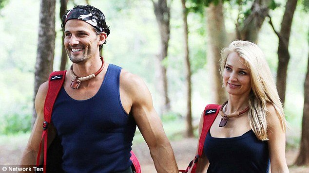 Happy to share! The pair were inseparable in the camp since they arrived holding hands but it seems the muscular hunk is happy to share his blonde beauty while she's still in the jungle and he's back in Bondi
