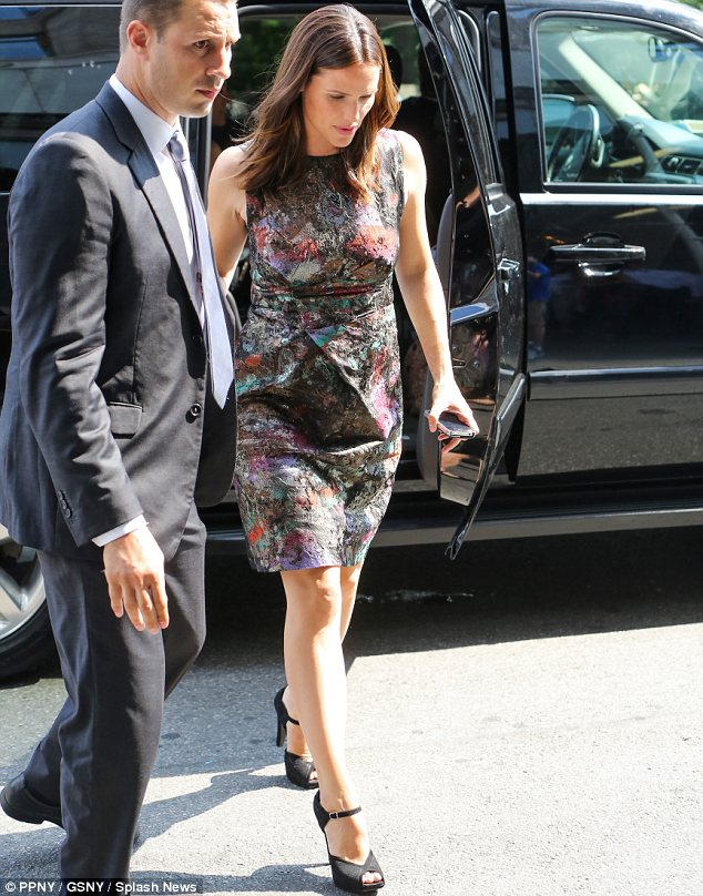 Dressed to impress: She later was seen in a printed shift as she arrived back to her hotel after a stint at the BET studios