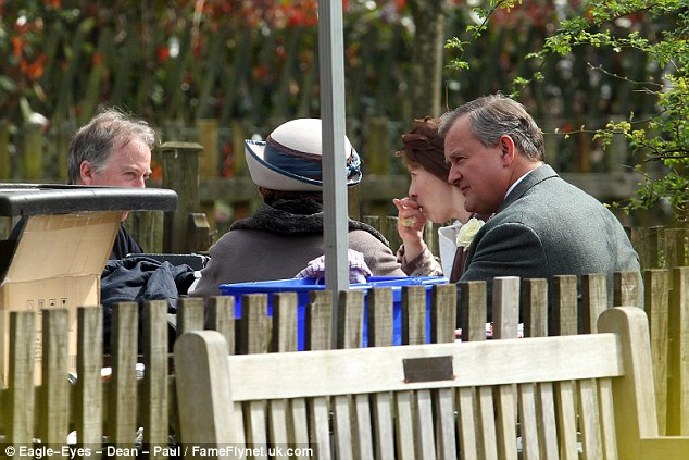Best man? Hugh Bonneville was pictured wearing a similar flower to Carson