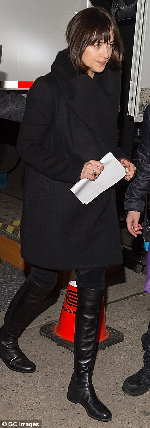 Mixing it up: The Fifty Shades Of Grey star traded in her furry footwear for sexy black leather boots at one point