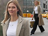 EXCLUSIVE: Karlie Kloss heads to a meeting wearing a beige tweed Coat and Adidas trainers, NYC  Pictured: Karlie Kloss Ref: SPL1151673  141015   EXCLUSIVE Picture by: Splash News  Splash News and Pictures Los Angeles: 310-821-2666 New York: 212-619-2666 London: 870-934-2666 photodesk@splashnews.com