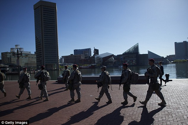 Members of the the National Guard monitor activity in the Inner Harbor of Baltimore today. Roughly 3,000 troops were deployed to Baltimore yesterday to prevent another night of violence