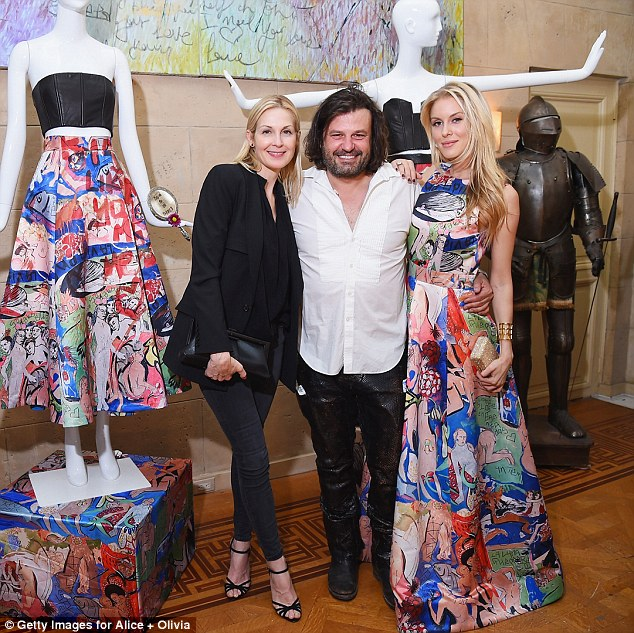 Fashionistas: Kelly is pictured next to designer Domingo Zapata and a guest