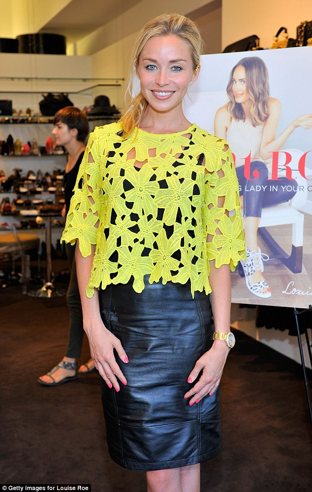 Sunny outlook: Ladies of London star Noelle, who has been grieving the loss of partner Scot Young since his death in December, smiled for the cameras in a yellow lace top and black leather skirt
