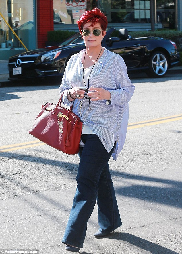 Sharon kept it casual in jeans and a loose short for the outing