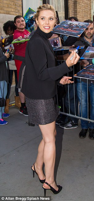 Sophisticated chic: The actress paired her mini skirt with a black turtleneck and peep-toe pumps