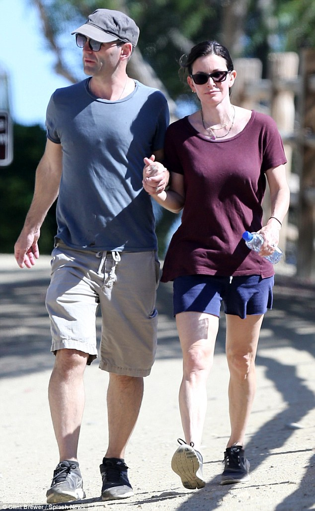 Solid as a rock! Courteney Cox showcased her engagement ring with fiance Johnny McDaid during a romantic hike in Malibu on Monday with their arms linked