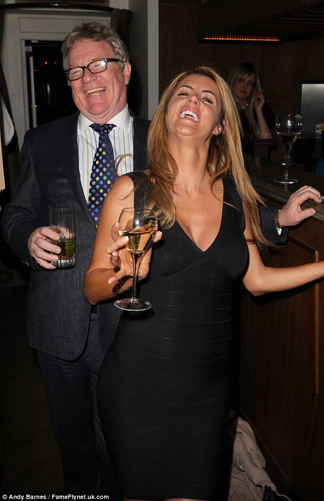 Letting their hair down: Jim appeared to be having a whale of a time as he cosied up to 2014 BB winner Helen Wood
