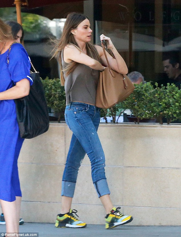 Enviable shape: She looked lovely and relaxed as she went about her day, taking time off from her busy schedule