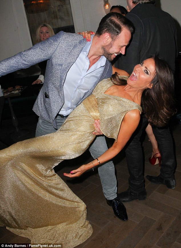 In a spin: Jason showed off his moves as she threw Lizzie around on the dance floor