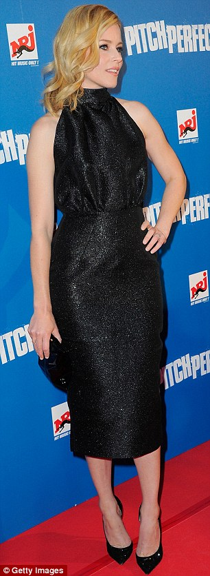 All that glitters... The actress and film-maker dazzled in a shimmering high halterneck black sleeveless dress