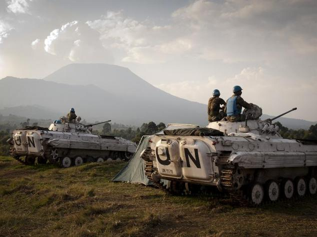Indian soldiers of the United Nations mission in Democratic Republic of Congo (MONUSCO) sit on the top of tanks at a military post in Kibati, some 10 km from...