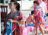 Coleen Rooney is pictured at the beach with family while on holiday in Barbados. Pics taken Oct 14th.  Pictured: Coleen Rooney Ref: SPL1150008  151015   Picture by: Splash News  Splash News and Pictures Los Angeles: 310-821-2666 New York: 212-619-2666 London: 870-934-2666 photodesk@splashnews.com