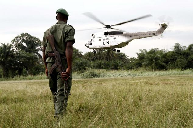 A soldier of the Congolese Defense Forces (FARDC) watches a UN helicopter from MONUSCO take off from Walikale in northeastern Democratic Republic of Congo on...