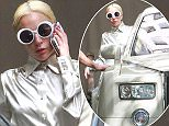 UK CLIENTS MUST CREDIT: AKM-GSI ONLY EXCLUSIVE: West Hollywood, CA - Lady Gaga takes a call as she exits Chateau Marmont in West Hollywood with her bodyguards in a white Rolls Royce.  Pictured: Lady Gaga Ref: SPL1152805  151015   EXCLUSIVE Picture by: AKM-GSI / Splash News