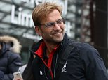 Jurgen Klopp is seen leading his players through Liverpool Lime Street train station. The German takes charge of his first game as Liverpool's manager tomorrow against Tottenham Hotspur, 16 October 2015. 16 October 2015. Please byline: Peter Goddard/Vantagenews.com
