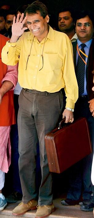 Union Railway Minister Suresh Prabhu leaves the Rail Bhavan for Parliament