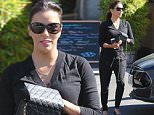 UK CLIENTS MUST CREDIT: AKM-GSI ONLY\nEXCLUSIVE: Studio City, CA - Eva Longoria smiles wide after lunch with a family member at Kiwami Japanese restaurant in Studio City. The former 'Desperate Housewives' star went casual in a black v-neck sweater, matching black jogger pants, flats and Chanel purse.\n\nPictured: Eva Longoria\nRef: SPL1153176  151015   EXCLUSIVE\nPicture by: AKM-GSI / Splash News\n\n