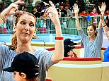 EXCLUSIVE: Celine Dion was spotted enjoying a day at Disneyland with her twin boys Nelson and Eddy Angelil. The trio were spotted taking a spin on the carousel, the teacups, and taking flight on Dumbo. The family spent a total of four days at the park, taking a break from her shows in Las Vegas.\n\nPictured:  Celine Dion, Nelson Angelil,  Eddy Angelil\nRef: SPL1135176  151015   EXCLUSIVE\nPicture by: Sharpshooter Images / Splash \n\nSplash News and Pictures\nLos Angeles: 310-821-2666\nNew York: 212-619-2666\nLondon: 870-934-2666\nphotodesk@splashnews.com\n