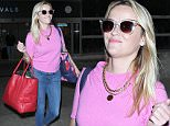 """Los Angeles, CA - Reese Witherspoon takes a page out of her """"Legally Blonde"""" character as she sports a cotton candy pink blouse paired with skinny denim jeans and an oversized bright red totebag.  The blonde beauty is seen arriving at LAX and appeared to be having a great day. \n  \nAKM-GSI      October 16, 2015\nTo License These Photos, Please Contact :\nSteve Ginsburg\n(310) 505-8447\n(323) 423-9397\nsteve@akmgsi.com\nsales@akmgsi.com\nor\nMaria Buda\n(917) 242-1505\nmbuda@akmgsi.com\nginsburgspalyinc@gmail.com"""