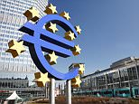 Euro sign and European Central Bank, Frankfurt, Germany.