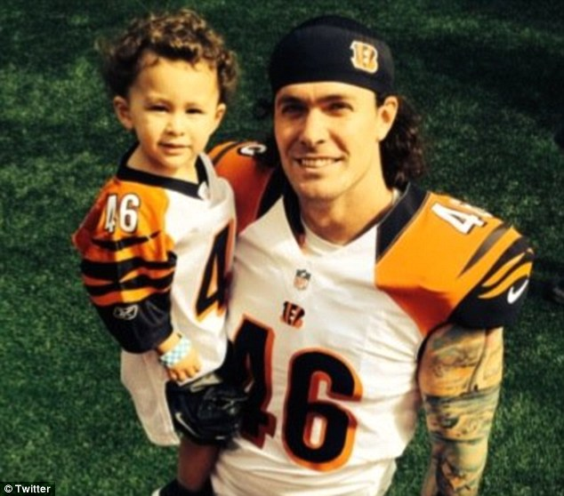 Trent (left), son of Cincinnati Bengals longsnapper Clark Harris (right), performed the National Anthem at his dad's former high school inManahawkin, New Jersey