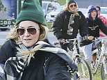 EXCLUSIVE: **PREMIUM EXCLUSIVE RATES APPLY*Madonna enjoys a day off from her 'Rebel Heart' tour in Vancouver with a brisk cycling workout at Stanley Park. The waterfront park is a must-do for tourists in the city, and it looks like Madge is making the most of her stay in the city. Flanked by tour staff, the group cycled at a brisk pace.\n\nPictured: Madonna,\nRef: SPL1152656  161015   EXCLUSIVE\nPicture by: Splash News\n\nSplash News and Pictures\nLos Angeles: 310-821-2666\nNew York: 212-619-2666\nLondon: 870-934-2666\nphotodesk@splashnews.com\n