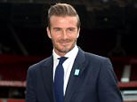 Former footballer David Beckham stands on the Old Trafford pitch to launch the upcoming UNICEF Match for Children, during a photocall at Old Trafford, Manchester.   PRESS ASSOCIATION Photo. Picture date: Tuesday October 6, 2015. See PA story SOCCER Beckham. Photo credit should read: Martin Rickett/PA Wire.