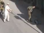 ATTENTION EDITORS - VISUAL COVERAGE OF SCENES OF INJURY OR DEATHA Jewish settler holding his pistol after he shot and killed a Palestinian man is seen in this still image taken from a video shot by Youth Against Settlements and obtained by Reuters TV, in the West Bank city of Hebron October 17, 2015. Three Palestinians were shot dead on Saturday in what Israel said were thwarted knife attacks, but a Palestinian witness of one incident said it was a result of Jewish settler violence, as tensions ran high after more than two weeks of unrest. The shooting occurred near a Jewish settlement in the West Bank city of Hebron. The Israeli military said a Palestinian attempted to stab an Israeli civilian, who was carrying a gun and then shot and killed the attacker. REUTERS/REUTERS TV/  ATTENTION EDITORS - THIS PICTURE WAS PROVIDED BY A THIRD PARTY. REUTERS IS UNABLE TO INDEPENDENTLY VERIFY THE AUTHENTICITY, CONTENT, LOCATION OR DATE OF THIS IMAGE. EDITORIAL USE ONLY. NOT FOR SALE FOR MARKETING
