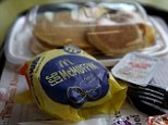 """FAIRFIELD, CA - JULY 23:  A McDonald's """"Big Breakfast"""" and Egg McMuffin are displayed at a McDonald's restaurant on July 23, 2015 in Fairfield, California.  McDonald's has been testing all-day breakfast menus at select locations in the U.S. and could offer it at all locations as early as October.  (Photo illustration by Justin Sullivan/Getty Images)"""