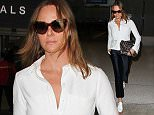 LOS ANGELES, CA, USA - OCTOBER 15: Fashion designer Stella McCartney seen at LAX Airport on October 15, 2015 in Los Angeles, California, United States. (Photo by Image Press/Splash News)  Pictured: Stella McCartney Ref: SPL1153202  151015   Picture by: Image Press / Splash News  Splash News and Pictures Los Angeles: 310-821-2666 New York: 212-619-2666 London: 870-934-2666 photodesk@splashnews.com