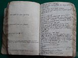 The King James Bible is the most widely read work in English literature, a masterpiece of translation whose stately cadences and transcendent phrases have long been seen, even by secular readers, as having emerged from a kind of collective divine inspiration.  But now, in an unassuming notebook held in an archive at the University of Cambridge, an American scholar has found what he says is an important new clue to the earthly processes behind that masterpiece: the earliest known draft, and the only one definitively written in the hand of one of the roughly four dozen translators who worked on it.  The notebook, which dates from 1604 to 1608, was discovered by Jeffrey Alan Miller, an assistant professor of English at Montclair State University in New Jersey, who announced his research on Wednesday in an article in The Times Literary Supplement.